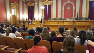 Bishop Jim Gonia addresses an audience gathered to learn about the refugee and asylum process at the Old Supreme Court Chambers in the Colorado Capitol on March 14.