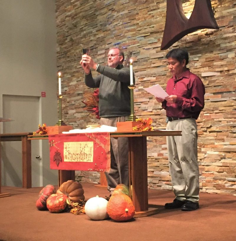 Thanksgiving worship led by Pr. Samee Singkeovilay (right) and Pr. Brian Malison