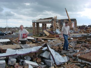 Director Kevin Massey and Associate Director Mike Nevergall stand among what is left of Peace Lutheran Church