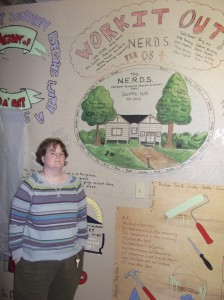 Suzie Harvey in front of the art work inside Camp Victor