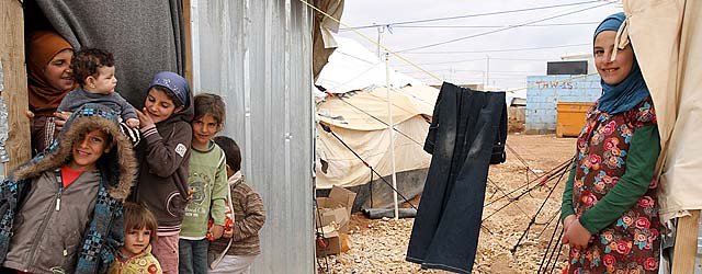 Children in the Za'atri refugee camp play outside their newly installed winterized shelter. Credit: A. G. Riisnes/NCA