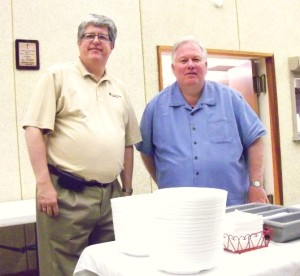Pastor Michael Stadie (left) Program Director of Lutheran Disaster Response, Pastor Roger Bruns of Trinity Lutheran Church at the table that serves meals to volunteers who come to Oklahoma City to help with clean up.