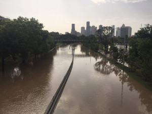 Flood waters cover Memorial Drive along Buffalo Bayou in Houston, Texas May 26, 2015 in a photo provided by the Harris County Flood Control District. Torrential rains have killed at least eight people in Texas and Oklahoma, including two in Houston where flooding turned streets into rivers and led to nearly 1,000 calls for help in the fourth-most populous U.S. city, officials said on Tuesday. REUTERS/Harris County Flood Control District/handout via Reuters - RTX1EN9D