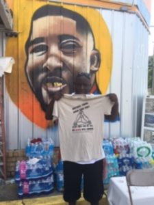 "Jamal at the Triple S Convenience Store. T-shirt reads ""Brothers Throw Down Your Guns! Jesus Died For Us All. His Blood Was Enough"