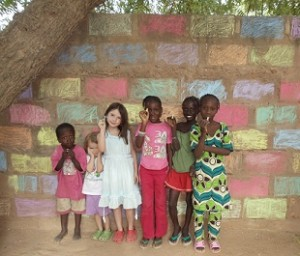 From left to right, Tall, Ellen, Eva, Soxna, Ndeye Fal and Ramata take a break to pose in front of their garden artwork.