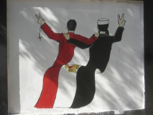 aAn Egyptian flag morphs into a Christian priest and a Muslim imam.