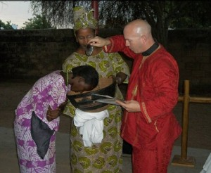 "Fatimata Ba, Aminata Ba, and Dirk at the Pentecost worship. Afterwards, as  we welcomed Fatimata with song, Aminata danced with the wooden bowl,  which is a Fulani ""milk pail"" now being used as a baptismal font."