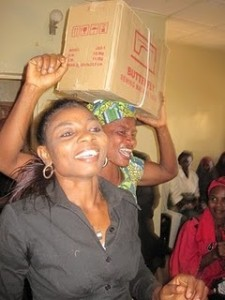 The women praise God when they receive the sewing machines.