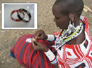 The Maasai women make beaded bracelets to raise money to build homes.