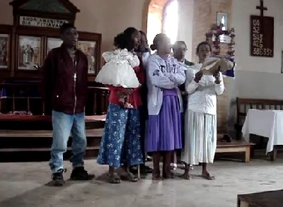 Singers offer the gift of music to Austin and Tanya Propst, who were visiting the congregation in Madagascar.