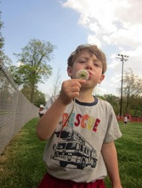 Caedmon makes a wish with a dandelion.