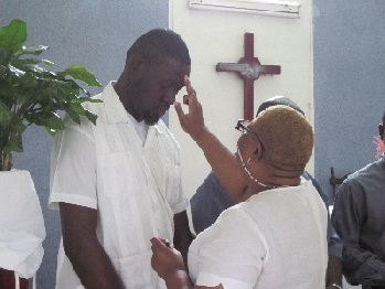 Anointing a new graduate.