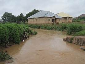 In the rainy season, the river by the school keeps some children from attending.