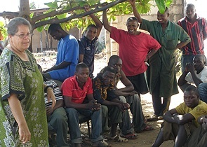 Barbara Robertson discusses AIDS prevention with young men in Tanzania.