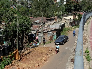 In Addis Ababa, a city of contrasts, expensive, one-family villas are near much humbler homes.