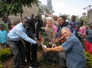 The welcome by the congregation included planting a tree.