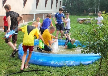 Cooling off with water games at the summer church camp.