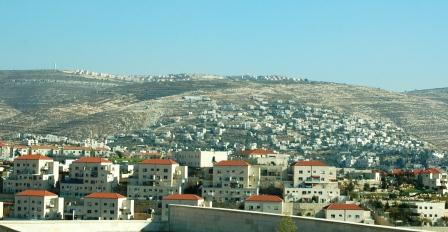 Typical Israeli settlements, one above and one below a Palestinian village.